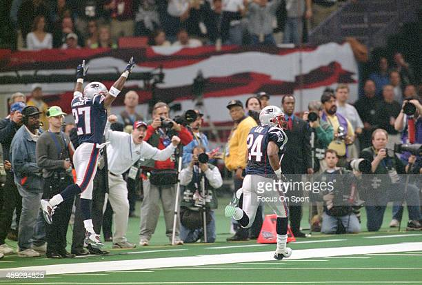 Ty Law of the New England Patriots returns an interception forty seven yards for a touchdown against St. Louis Rams during Super Bowl XXXVI at the...