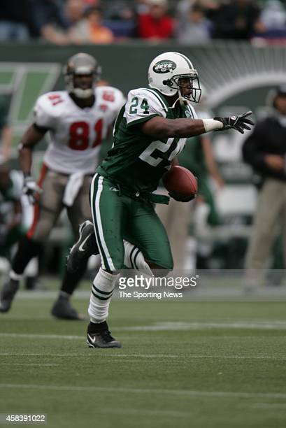 Ty Law of the New York Jets runs with the ball during a game against the Tampa Bay Buccaneers on October 09, 2005 at the Meadowlands Stadium in East...
