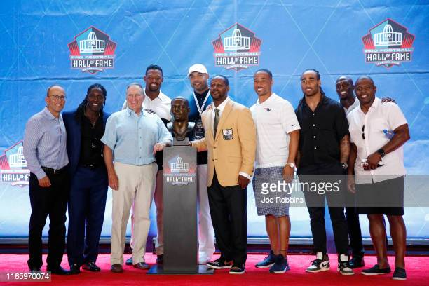 Ty Law poses with former New England Patriots teammates during his enshrinement into the Pro Football Hall of Fame at Tom Benson Hall Of Fame Stadium...