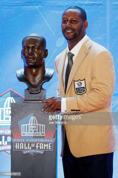 Ty Law poses with his bust during his enshrinement into the Pro Football Hall of Fame at Tom Benson Hall Of Fame Stadium on August 3 2019 in Canton...