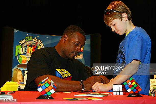 Ty Law signs autographs at the You CAN Do the Rubik's Cube event at 1 Science Park on November 19, 2011 in Boston, Massachusetts.