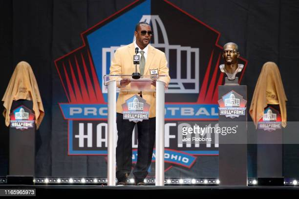 Ty Law speaks during his enshrinement in the Pro Football Hall of Fame at Tom Benson Hall Of Fame Stadium on August 3, 2019 in Canton, Ohio.