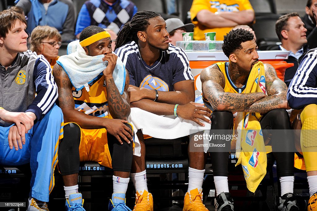 Ty Lawson #3, Kenneth Faried #35, and Wilson Chandler #21 of the Denver Nuggets look on from the bench as their teammates play against the Golden State Warriors in Game Two of the Western Conference Quarterfinals during the 2013 NBA Playoffs on April 23, 2013 at the Pepsi Center in Denver, Colorado.