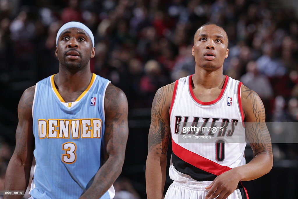 Ty Lawson #3 of the Denver Nuggets and Damian Lillard #0 of the Portland Trail Blazers walk off the court during the game on February 27, 2013 at the Rose Garden Arena in Portland, Oregon.