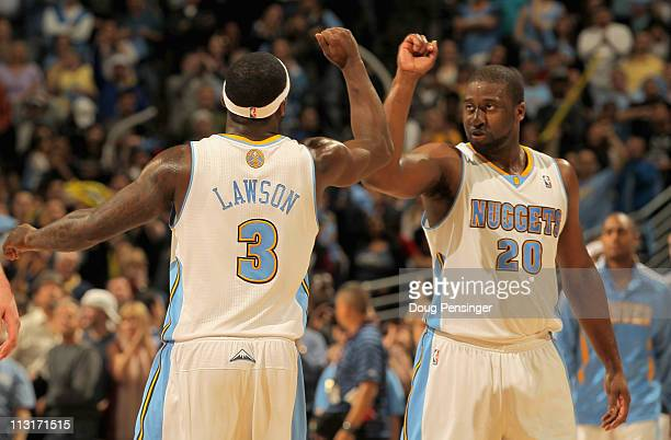 Ty Lawson of the Denver Nuggets and Raymond Felton of the Denver Nuggets celebrate late in the fourth quarter against the Oklahoma City Thunder in...