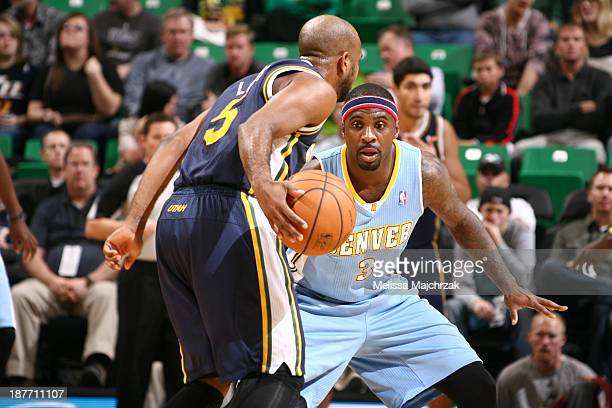 Ty Lawson of the Denver Nuggets defends against John Lucas III of the Utah Jazz at EnergySolutions Arena on November 11, 2013 in Salt Lake City,...
