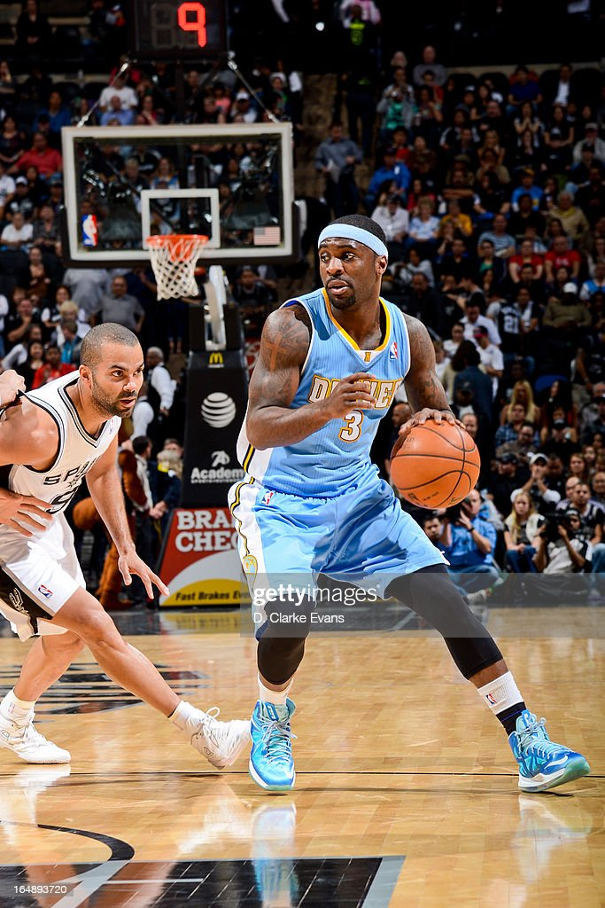 Ty Lawson #3 of the Denver Nuggets drives against Tony Parker #9 of the San Antonio Spurs on March 27, 2013 at the AT&T Center in San Antonio, Texas.