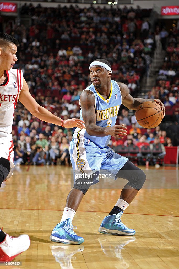 Ty Lawson #3 of the Denver Nuggets drives to the basket against the Houston Rockets on January 23, 2013 at the Toyota Center in Houston, Texas.