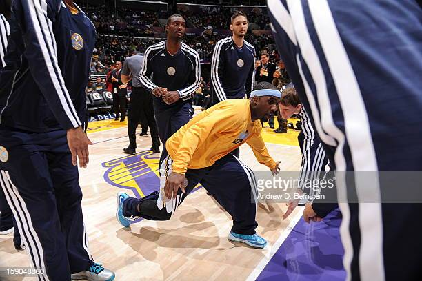 Ty Lawson of the Denver Nuggets greets teammates before playing against the Los Angeles Lakers at Staples Center on January 6 2013 in Los Angeles...