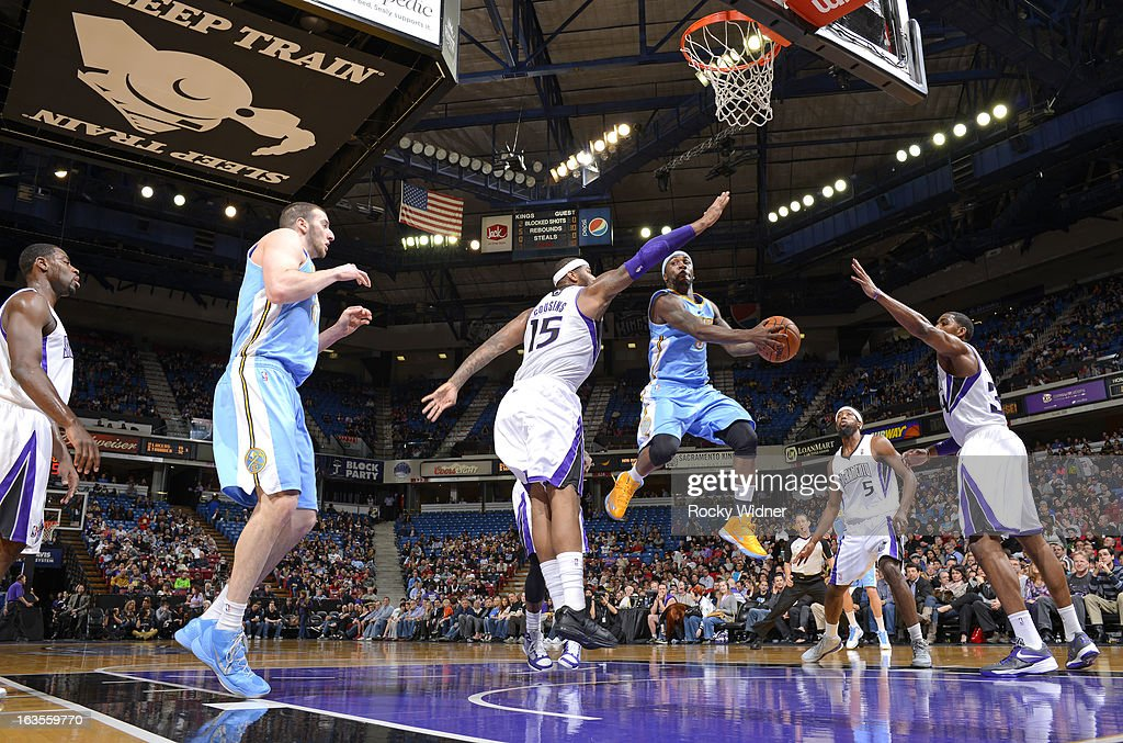 Ty Lawson #3 of the Denver Nuggets passes against DeMarcus Cousins #15 of the Sacramento Kings on March 5, 2013 at Sleep Train Arena in Sacramento, California.
