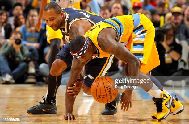 Ty Lawson of the Denver Nuggets steals the ball from Mo Williams of the Utah Jazz at the Pepsi Center on November 9 2012 in Denver Colorado NOTE TO...