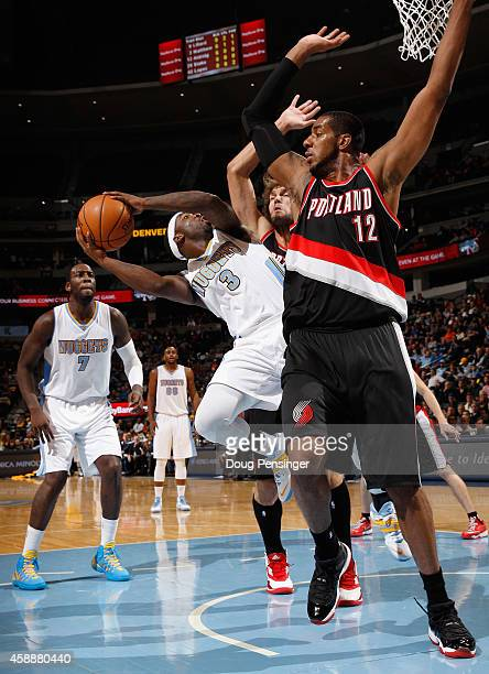 Ty Lawson of the Denver Nuggets tries to get off a shot against LaMarcus Aldridge of the Portland Trail Blazers at Pepsi Center on November 12 2014...