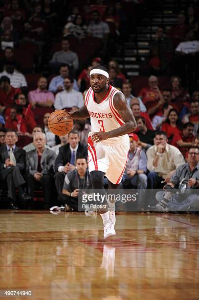 Ty Lawson of the Houston Rockets brings the ball up court against the Brooklyn Nets on November 11 2015 at the Toyota Center in Houston Texas NOTE TO...