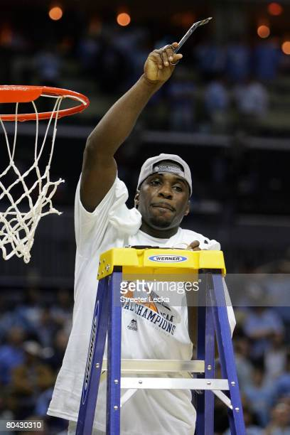 Ty Lawson of the North Carolina Tar Heels cuts down the net after defeating the Louisville Cardinals during the 2008 NCAA Men's East Regional Final...