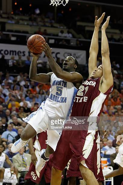 Ty Lawson of the North Carolina Tar Heels goes up for a shot over Julian Vaughn of the Florida State Seminoles during day two of the 2008 Men's ACC...