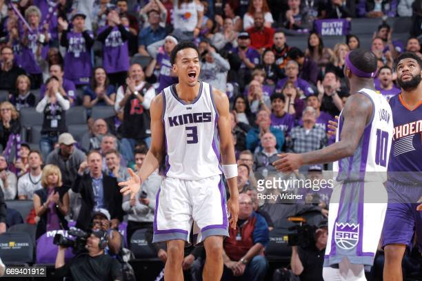 Ty Lawson of the Sacramento Kings celebrates with teammate Skal Labissiere after getting a triple double against the Phoenix Suns on April 11 2017 at...