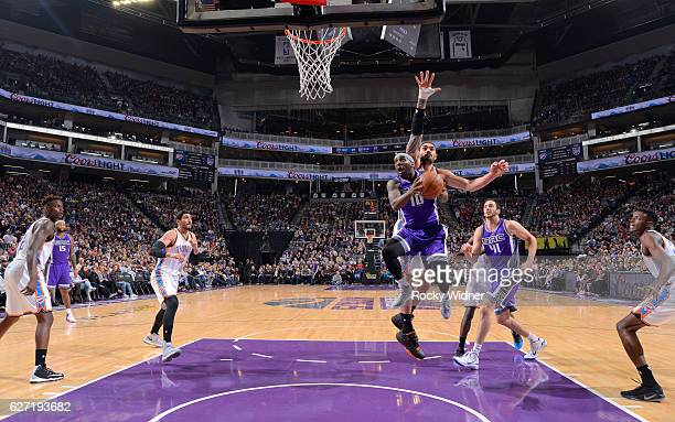 Ty Lawson of the Sacramento Kings goes up for the shot against Steven Adams of the Oklahoma City Thunder on November 23 2016 at Golden 1 Center in...