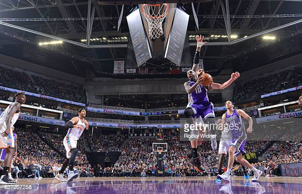 Ty Lawson of the Sacramento Kings goes up for the shot against Steven Adams of the Oklahoma City Thunder on November 23, 2016 at Golden 1 Center in...