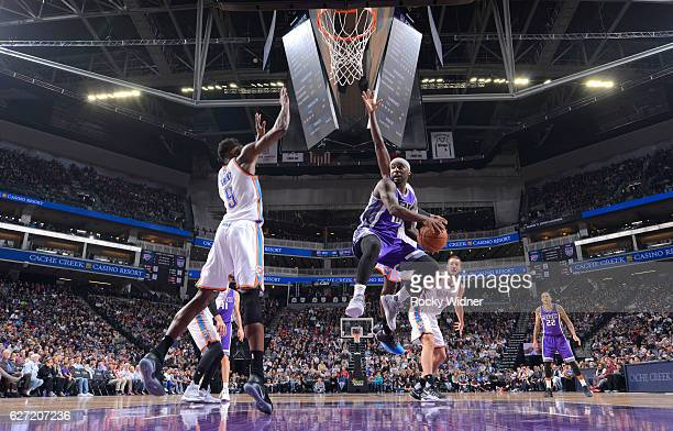 Ty Lawson of the Sacramento Kings passes against Jerami Grant of the Oklahoma City Thunder on November 23 2016 at Golden 1 Center in Sacramento...