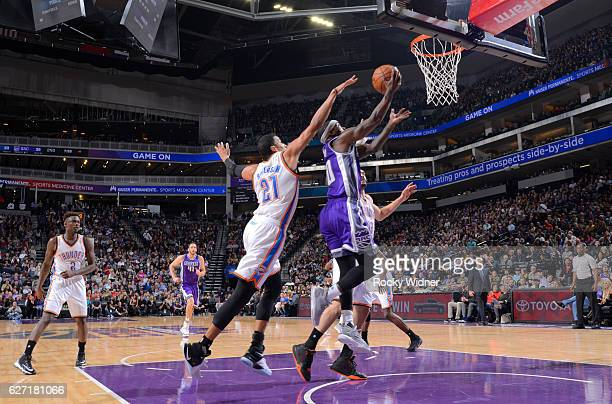 Ty Lawson of the Sacramento Kings shoots a layup against Andre Roberson of the Oklahoma City Thunder on November 23 2016 at Golden 1 Center in...