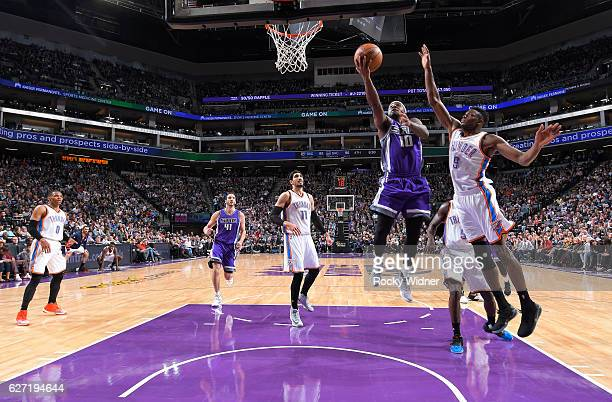 Ty Lawson of the Sacramento Kings shoots a layup against Jerami Grant of the Oklahoma City Thunder on November 23 2016 at Golden 1 Center in...