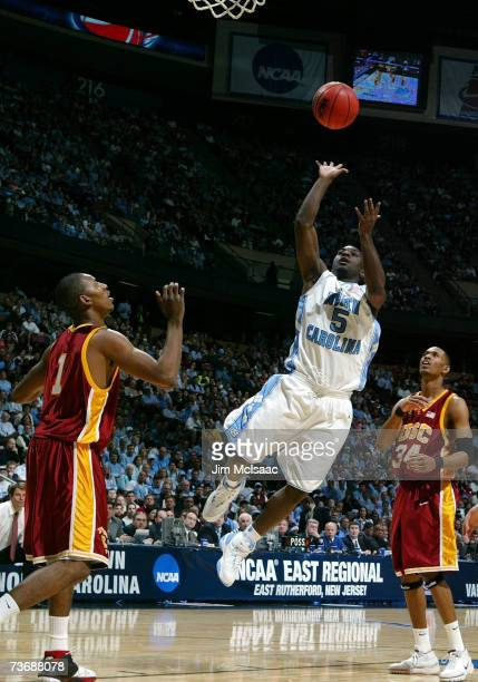 Ty Lawson of the University of North Carolina Tar Heels shoots the ball over Nick Young of the University of Southern California Trojans during the...