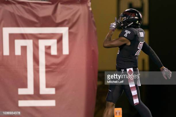 Ty Mason of the Temple Owls reacts after intercepting a pass and returns it for a touchdown in the first quarter against the Tulsa Golden Hurricane...