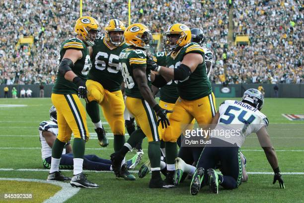 Ty Montgomery of the Green Bay Packers celebrates with teammates after scoring a 6yard rushing touchdown during the third quarter against the Seattle...