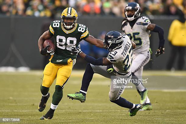 Ty Montgomery of the Green Bay Packers is pursued by Steven Terrell of the Seattle Seahawks during the first half of a game at Lambeau Field on...