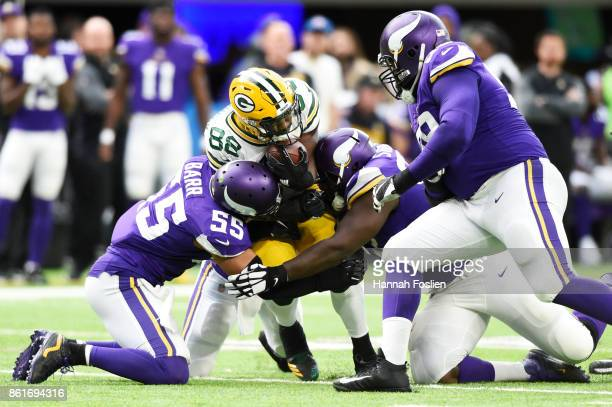 Ty Montgomery of the Green Bay Packers is tackled by Anthony Barr and Shamar Stephen of the Minnesota Vikings during the second quarter of the game...