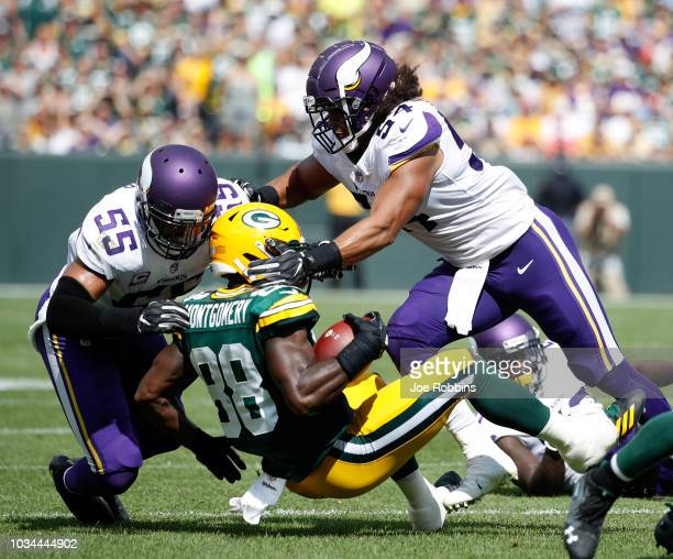 Ty Montgomery of the Green Bay Packers is tackled by Anthony Barr of the Minnesota Vikings and Eric Kendricks during the second quarter of a game at...