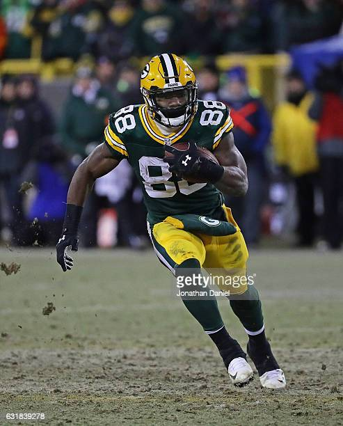 Ty Montgomery of the Green Bay Packers runs against the New York Giants at Lambeau Field on January 8 2017 in Green Bay Wisconsin