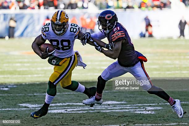 Ty Montgomery of the Green Bay Packers runs the football into the endzone against Tracy Porter of the Chicago Bears for a touchdown in the first...