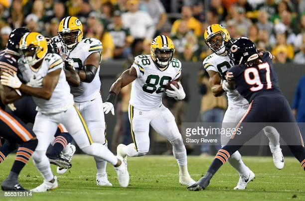 Ty Montgomery of the Green Bay Packers runs with the ball in the first quarter against the Chicago Bears at Lambeau Field on September 28 2017 in...