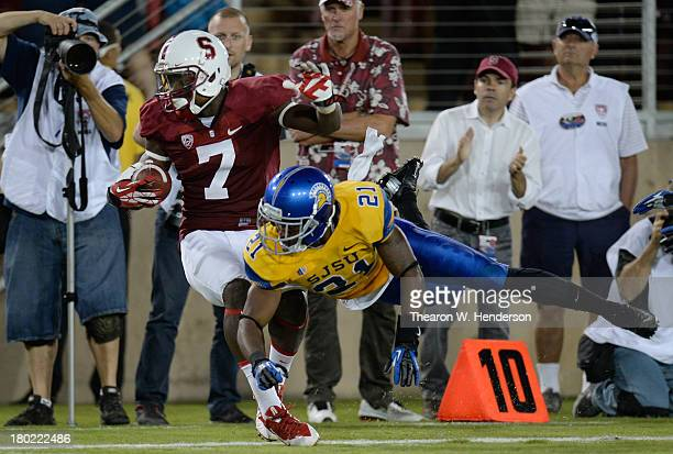 Ty Montgomery of the Stanford Cardinal after a forty two yard pass play gets knocked out of bounds at the six yard line by Bene Benwikere of the San...