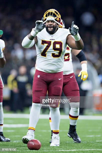 Ty Nsekhe of the Washington Redskins signals to the crowd after a big play during a game against the New Orleans Saints at MercedesBenz Superdome on...