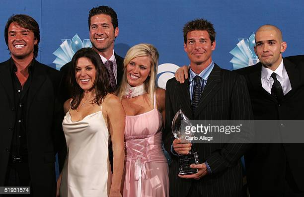 Ty Pennington and the cast of Extreme Makeover Home Edition poses with the Favorite Reality Show/ Makeover during the 31st Annual People's Choice...