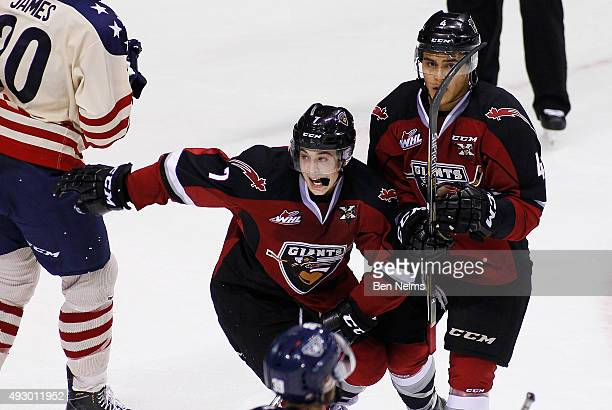 Ty Ronning and Clayton Kirichenko celebrate teammate Radovan Bondra's goal against the TriCity Americans during the second period of their WHL game...