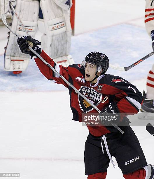 Ty Ronning celebrates teammate Radovan Bondra's goal against the TriCity Americans during the second period of their WHL game at the Pacific Coliseum...