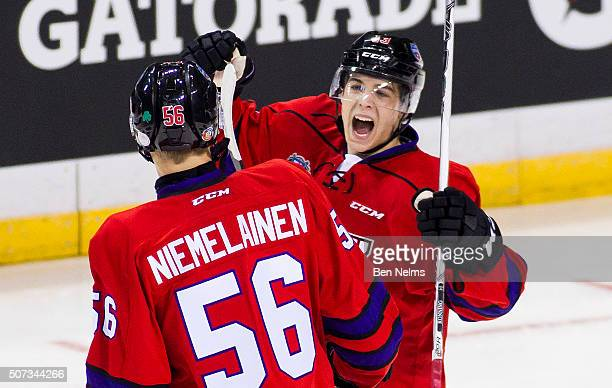 Ty Ronning of Team Cherry celebrates his goal against Team Orr with teammate Markus Niemelainen during the first period of their CHL/NHL Top...