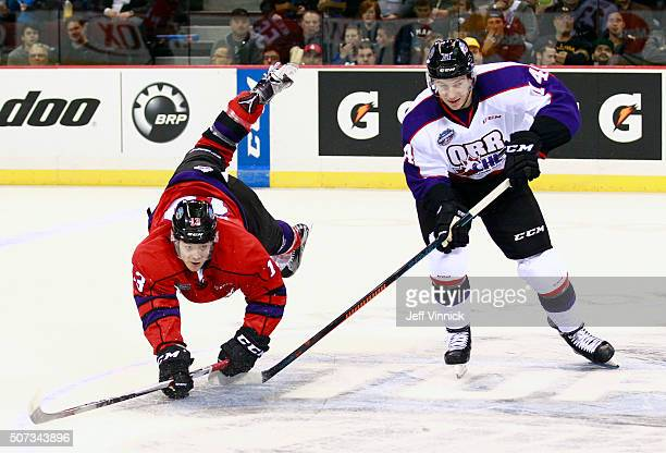 Ty Ronning of Team Cherry is checked by Nathan Bastian of Team Orr during the CHL/NHL Top Prospects Game January 28 2016 at Pacific Coliseum in...
