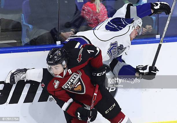 Ty Ronning of the Vancouver Giants avoids a hit from Regan Nagy of the Victoria Royals during the second period of their WHL game at the Langley...