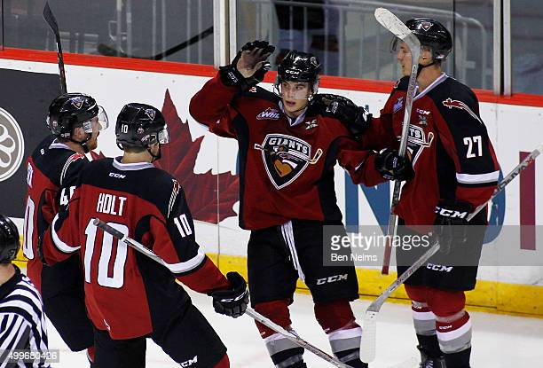 Ty Ronning of the Vancouver Giants celebrates his goal against the Medicine Hat Tigers with teammates Trevor Cox Dawson Holt and Ben Thomas during...