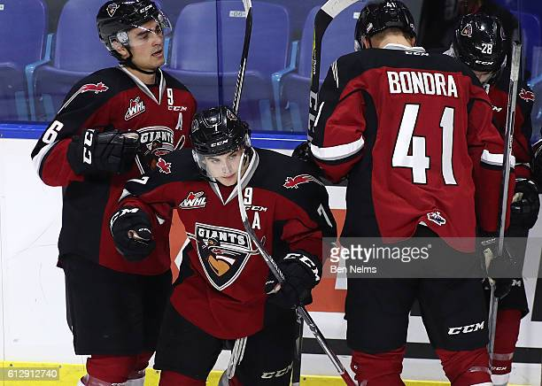 Ty Ronning of the Vancouver Giants celebrates his goal against the Victoria Royals with teammates Dylan Plouffe and Radovan Bondra during the second...