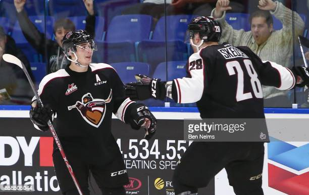 Ty Ronning of the Vancouver Giants celebrates his goal against the TriCity Americans with teammate Darian Skeoch during the third period of their WHL...