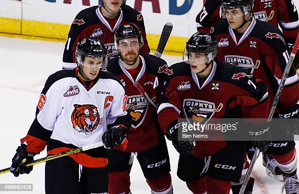 Ty Ronning of the Vancouver Giants celebrates his goal near Cole Sanford of the Medicine Hat Tigers with teammate Trevor Cox during the second period...
