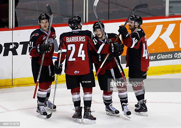 Ty Ronning of the Vancouver Giants celebrates his hattrick goal against the Medicine Hat Tigers with teammates Brennan Menell Matt Barberis and...