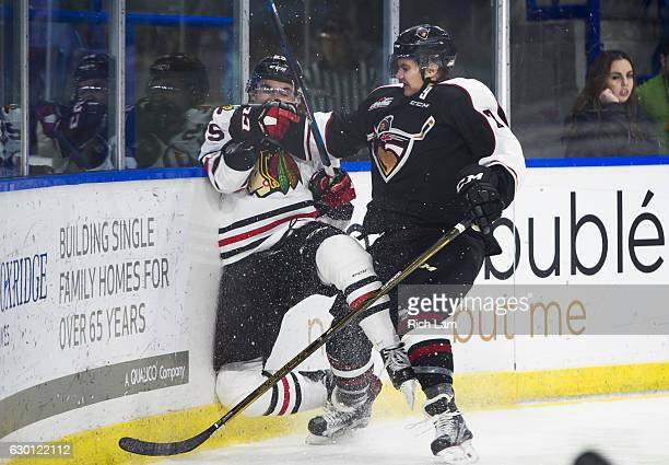 Ty Ronning of the Vancouver Giants check Evan Weinger of the Portland Winterhawks into the end boards during the third period of their WHL game at...