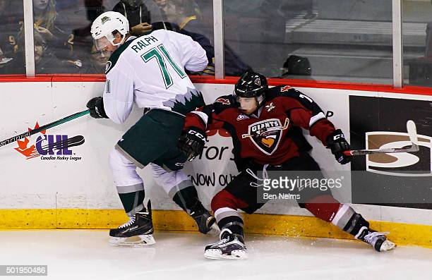 Ty Ronning of the Vancouver Giants is checked by Brandon Ralph of the Everett Silvertips during the second period of their WHL game at the Pacific...