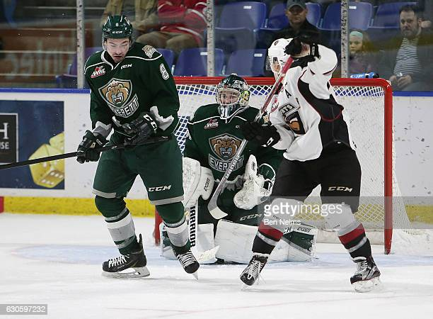 Ty Ronning of the Vancouver Giants is scores the overtime goal against goaltender Mario Petit of the Everett Silvertips during the second period of...